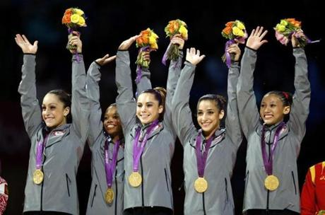 Jordyn Wieber, Gabrielle Douglas, McKayla Maroney, Alexandra Raisman, and Kyla Ross of the gold medal-winning US women's gymnastics team.